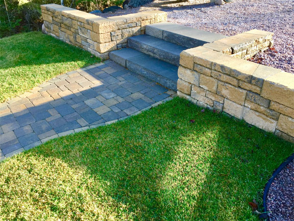 paving stones, retaining wall, and stone steps